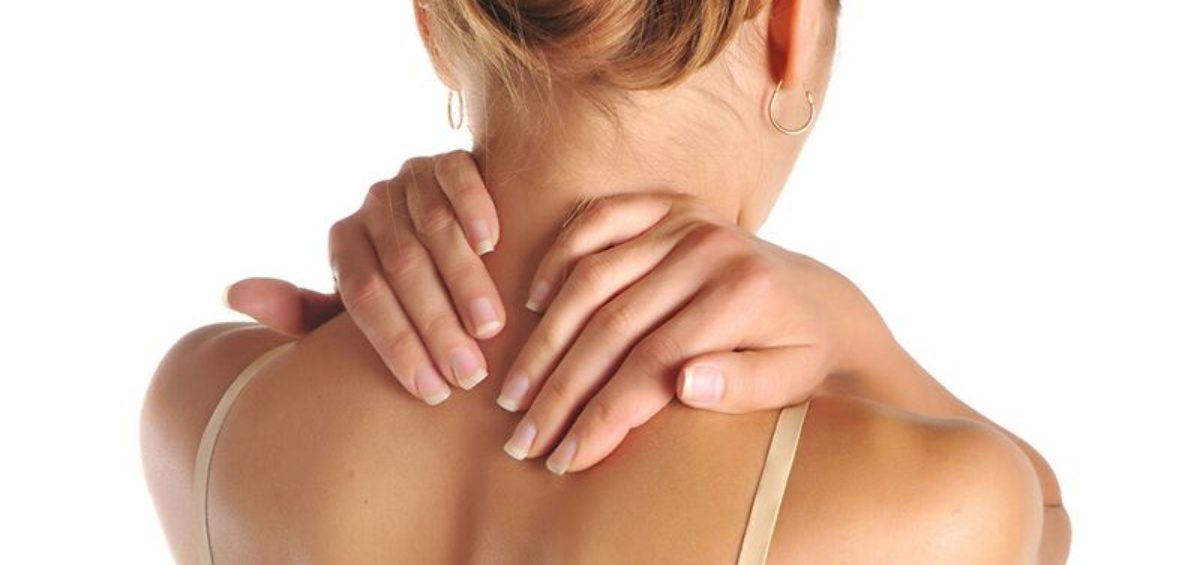 close up of woman holding sore neck