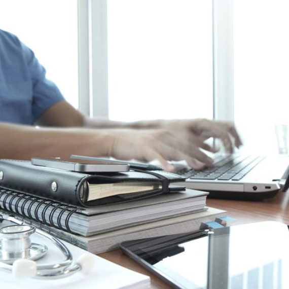 doctor typing, signs that your insurance agent in an expert in healthcare