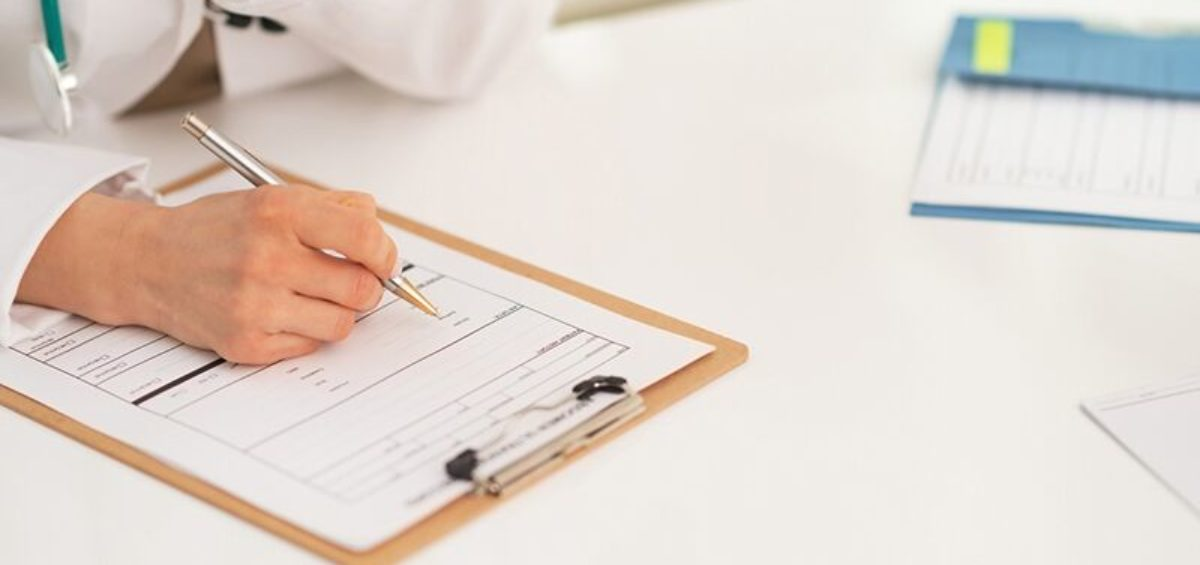 doctor filling out paperwork, what separates personal care and skilled care assessments