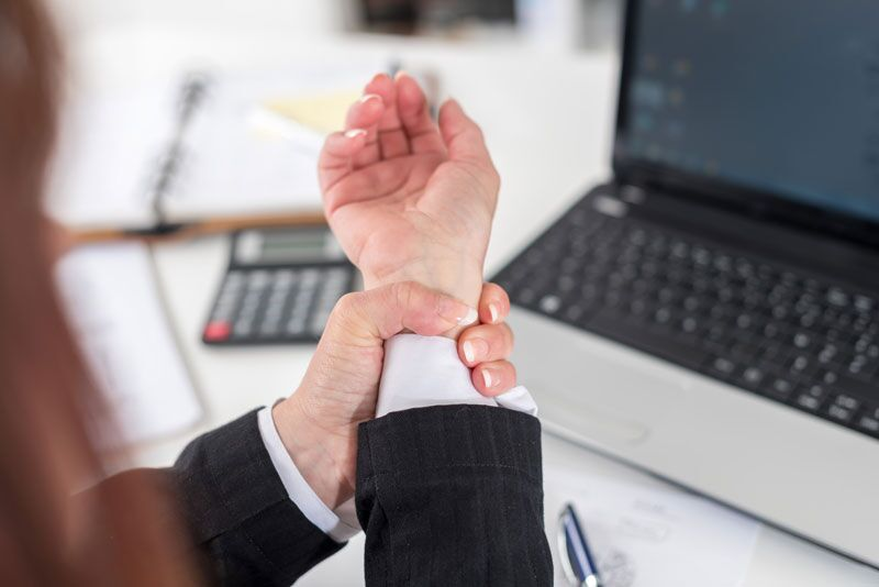 worker grabbing wrist in pain, risk of DOL strength classifications