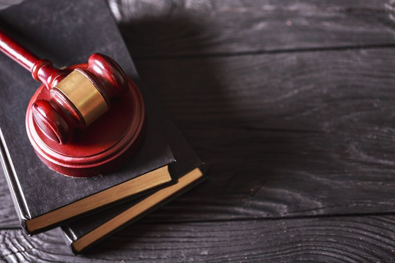 gavel and law books, workers compensation insurance fraud