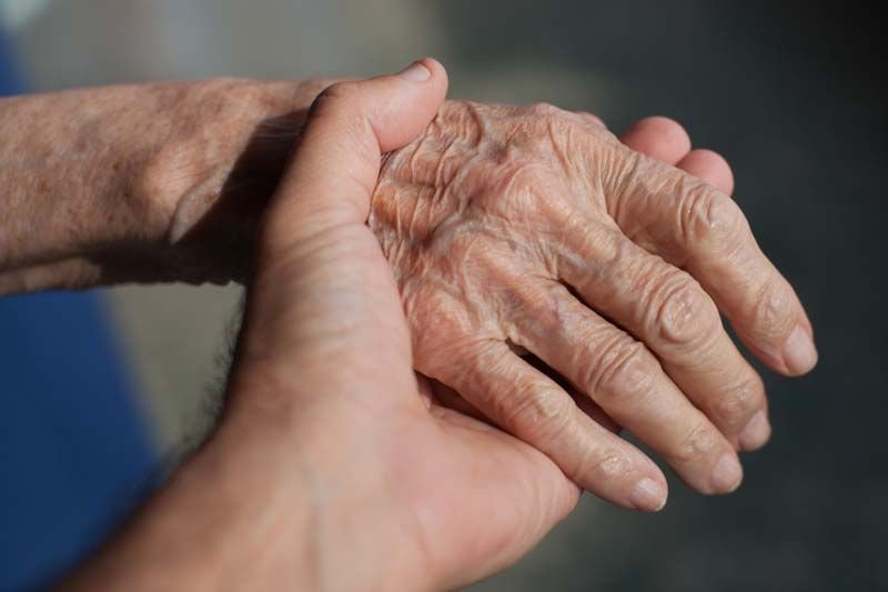 holding old person's hand, home healthcare and workers comp