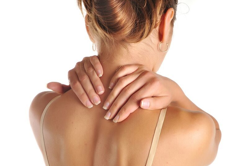 woman grabbing her neck in pain, prevent repetitive stress injuries among your healthcare staff